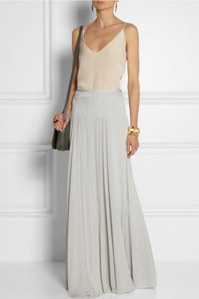Effortless chic in neutrals. Long silk maxi skirt by Malene Birger, gold bangle.