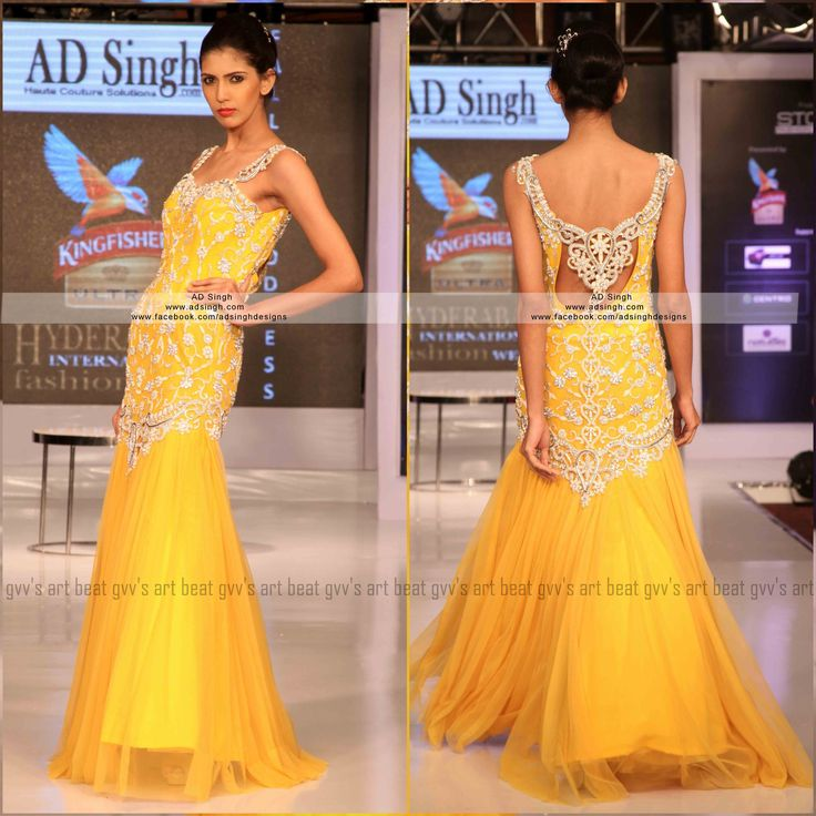 Yellow gown with our signature cut work back in pearls and swarovki elements, made in soft tulle nett. For more information  email: info@adsingh.com www.adsingh.com www.twitter.com/adsinghdesigns