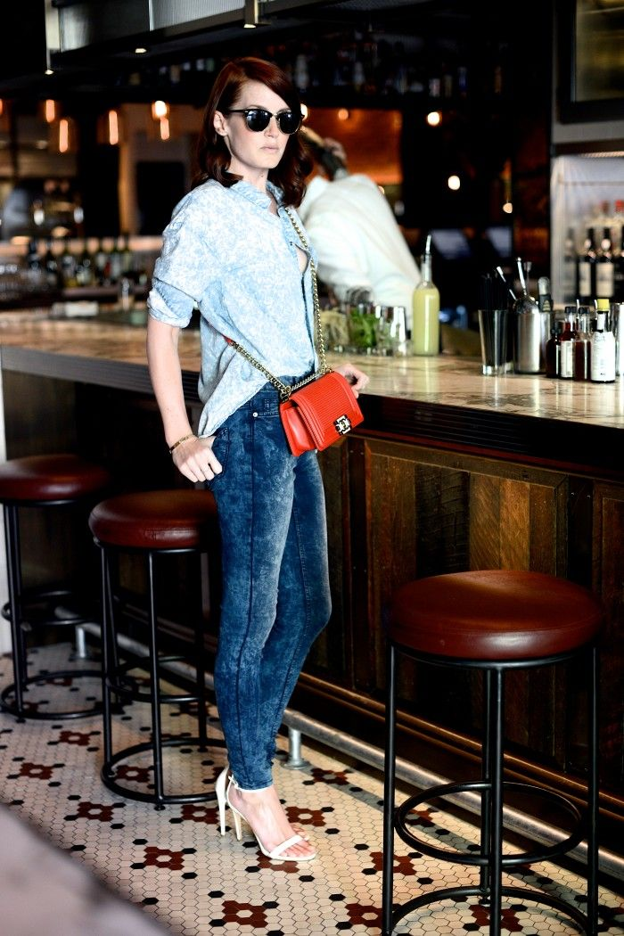 Shop this look for $102:  http://lookastic.com/women/looks/light-blue-shirt-and-red-crossbody-bag-and-navy-skinny-jeans-and-white-sandals/2138  — Light Blue Print Denim Shirt  — Red Leather Crossbody Bag  — Navy Print Skinny Jeans  — White Leather Sandals