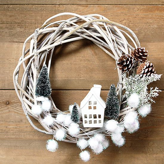 Tis the season for crafts, wreaths, and merriment. Here's how to create the cutest wreath on the street with our easy DIY. White pom-poms add a bit of whimsy. /