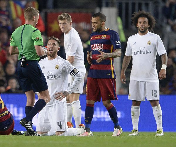 "Real Madrid's defender Sergio Ramos (L) talks to the referee moments before receiving a red card during the Spanish league ""Clasico"" football match FC Barcelona vs Real Madrid CF at the Camp Nou stadium in Barcelona on April 2, 2016."
