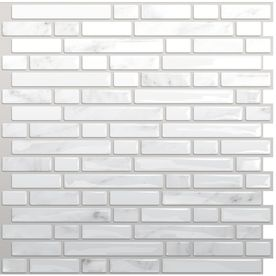 Self stick tiles from Lowe's - removable with hair dryer. Easy way to do a cheap backsplash or cover old tiles.