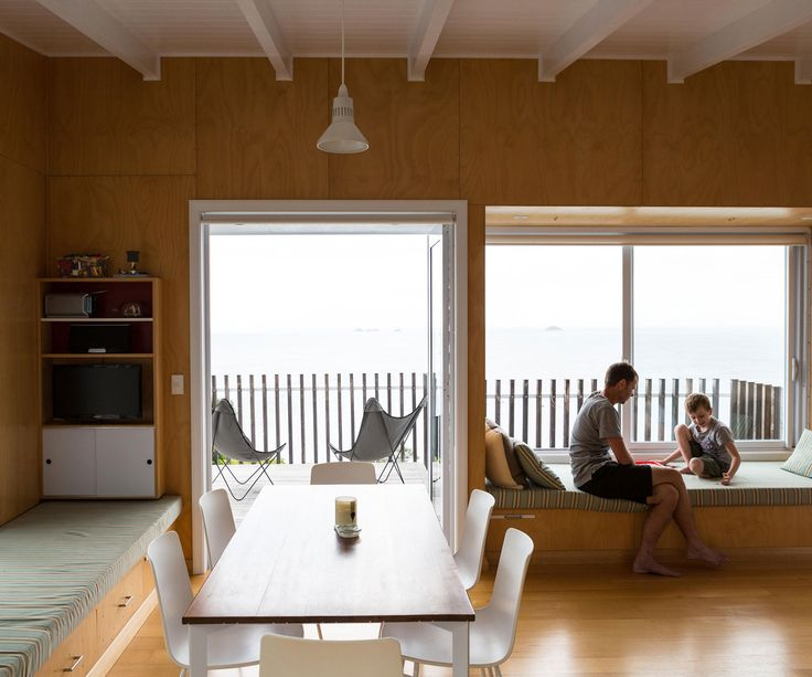 The Rakino Island bach keeps its small interior simple with built-in window seats allowing big sea views.