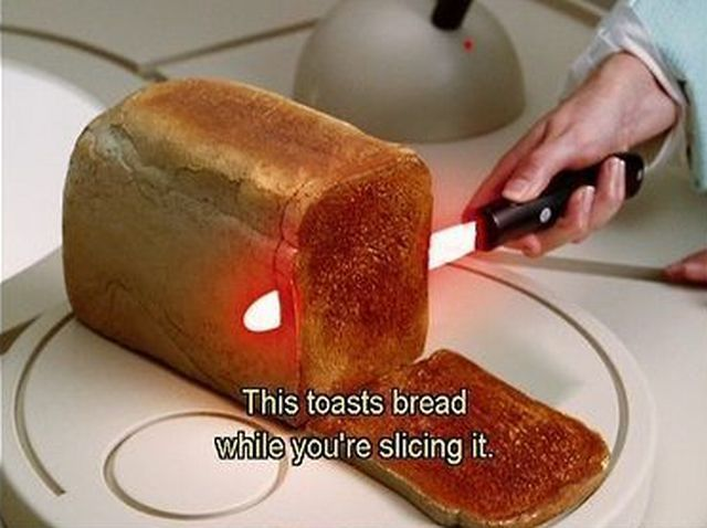 Toasts bread while it cuts. Are you FREAKIN kidding me! if this is real I MUST have one!