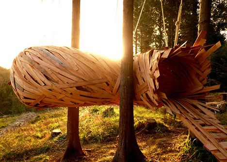 Students from London's Architectural Association have suspended a giant wooden cocoon between the trees of Hooke Park in Dorset, England (+ slideshow).