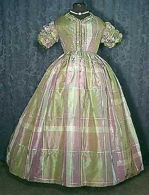 Pre Civil War Soft Plaid Taffeta Dress  A delightful circa 1855 to 1860 lady's one piece irridescent taffeta dress of a pretty soft olive green, shades of mauve and an accent of pale blue.   The lined bodice has a two dart construction and stays at the center and sides. A front hook and eye closure, piped drop shoulder seams and waist. A fine ruched accent to the neckline and front opening with lovely complimenting ruched and ruffled short sleeves trimmed there and at the front in green velvet b: Soft Olives, Front Hooks, Eye Closure, Civil War, Plaid Taffeta, Shorts Sleeve, Ruffles Shorts, Olives Green, Soft Plaid