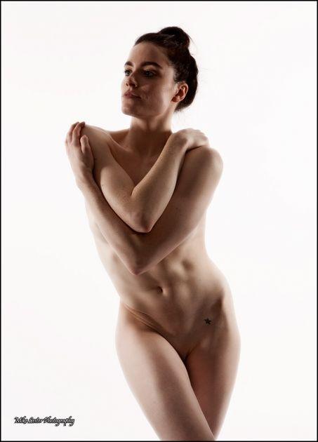 Girl posing nude in a recliner