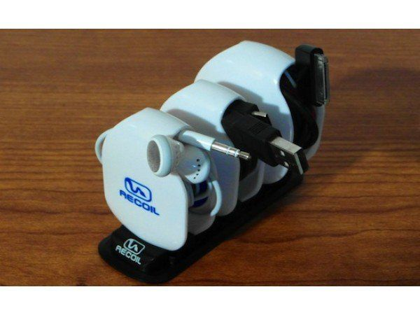Cord Winder, Cord Organizer from Recoil Winders, The Grommet - Nearly every device in our everyday life needs a cord to charge and we are taxed with constantly carrying them around everywhere. If tangled cords are a constant problem for you, Recoil Cord Winders are the solution.