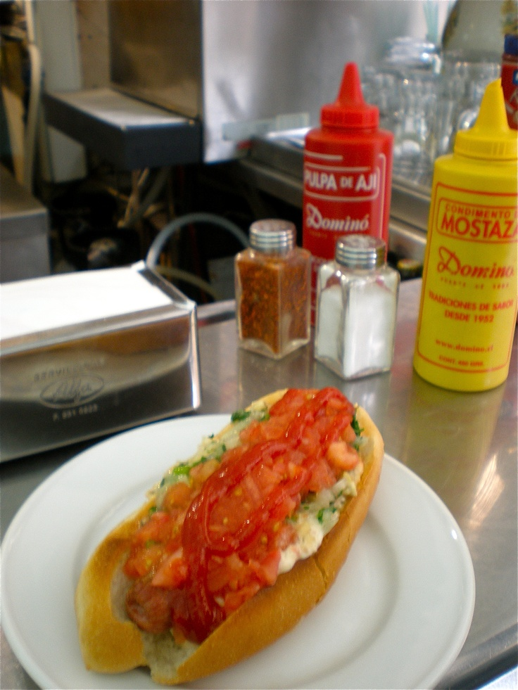 Completos from Domino (Chilean fast food joint with burgers and hot dogs). Weekly treat with this hot dog with avocado, house mayo and delicious salsa.