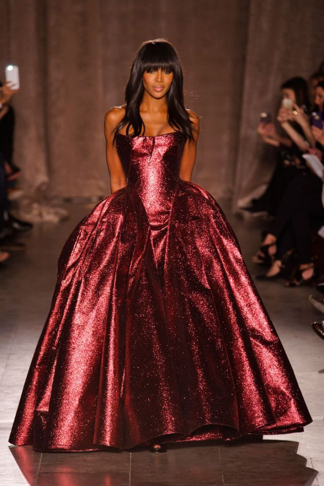 When Naomi Campbell stepped out onto the runway in this Zac Posen finale look, the crowd jumped to their feet and jaws dropped. The ruby red…