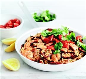 Chicken, shrimp and cherry tomatoes liven up easy paella from Donna Hay.