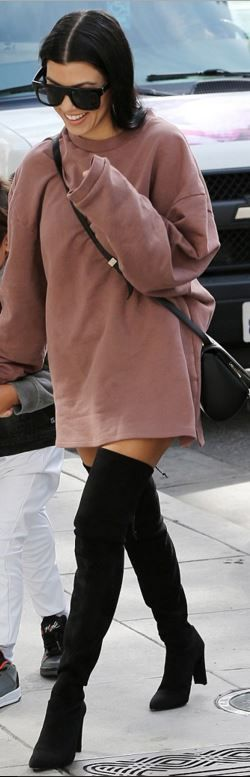Who made Kourtney Kardashian's pink sweatshirt, black leather handbag, suede thigh high boots, and sunglasses?
