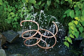 Copper spiral water feature DIY: http://kb.thegardener.co.za/article/copper-spiral-water-feature-diy.html