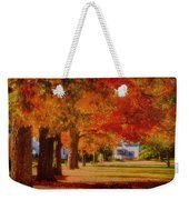 Row Of Maples Weekender Tote Bag by Jeff Folger. Row of maples by Jeff Folger. A row of maples in shades of green, gold, orange and even a little red. A walkway the borders the town common. Near to Concord in mid October, the afternoon colors greet anyone who walks this way with a cheerful hello!