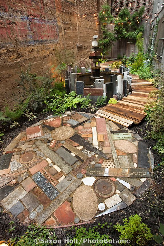 Mixed media patio. The garden Mark Twain Hotel design by Organic Mechanics
