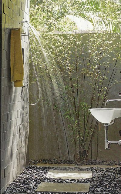 I love the idea of an out door shower next to a master bedroom. Bamboo for privacy, a nice rain shower and sink.