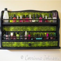Re-purpose an old spice rack into a stylish nail polish rack with a coat of paint and a roll of patterned duct tape.