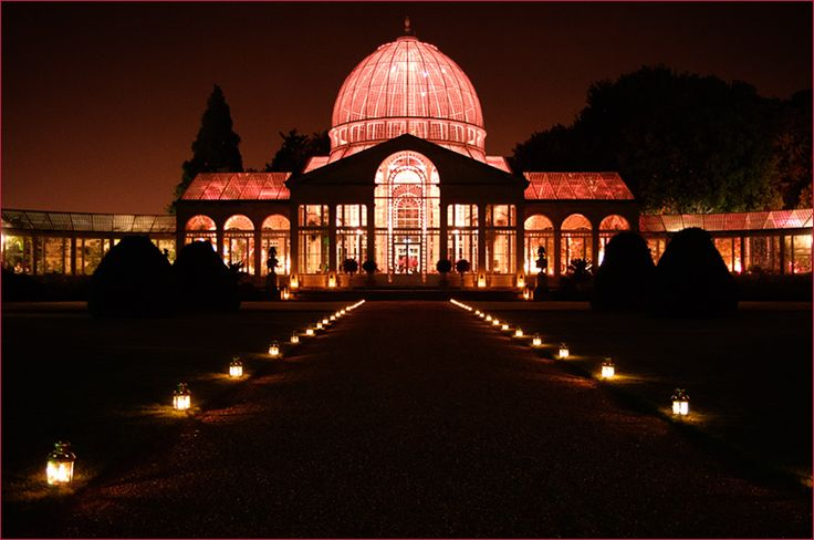 outside of great conservatory Syon Park wedding venue at night