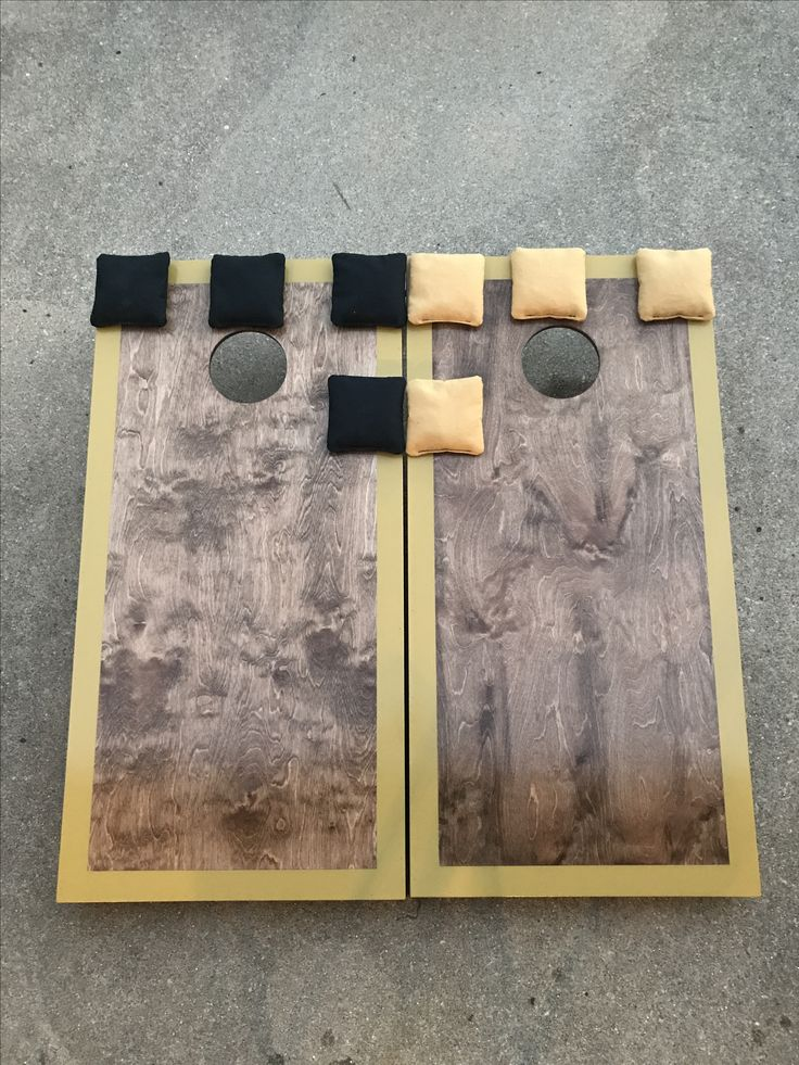 cornhole boards stained with a border