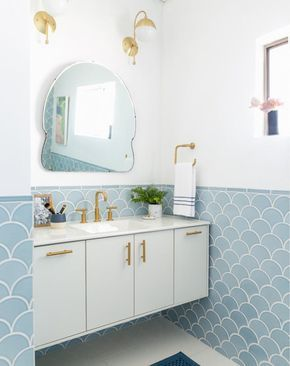Pale blue scallop tiles create a perfectly pretty powder room