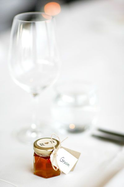 Nick's father provided small glass jars of fresh honey as bomboniere, which the couple personalised to double as place cards. Image by Sugarlove Weddings.