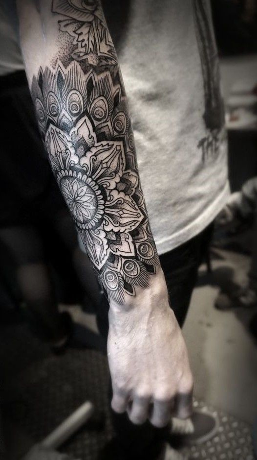 Awesome mandala sleeve tattoo.
