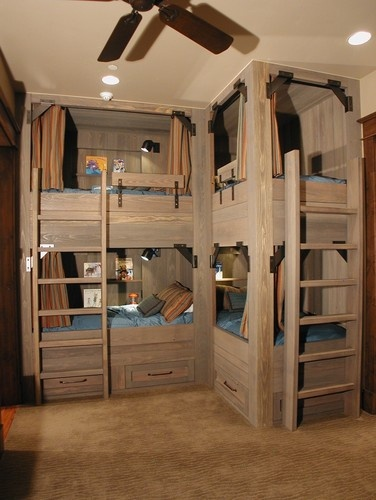 lots of kids in one room. for 3 kids, one bottom bunk (Lft in this pict) could be toy storage and play table.