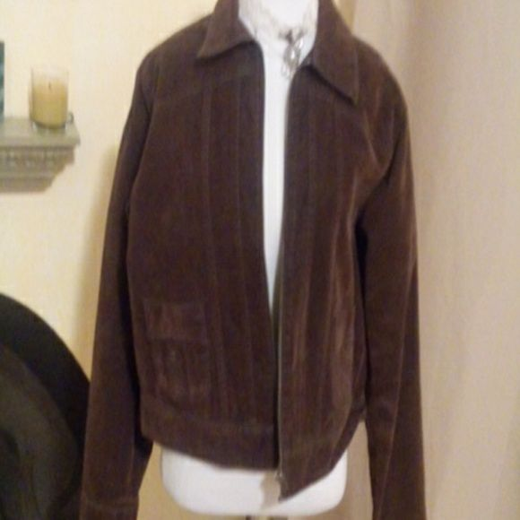 Vintage Suede Lee jacket,brown A brown suede jacket by Lee.Fits sizes large to medium.Has suede on the inside and denim on the outside.100% Cotton.In excellent condition.Has two small pockets in front and zips up the front.Nice looking jacket:)) Jackets & Coats