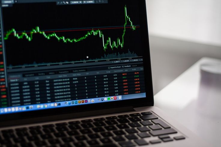 Black Laptop Computer Showing Stock Graph  Free Stock Photo