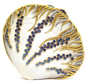 Verdura compact made from a natural shell, gold, diamond and sapphire.