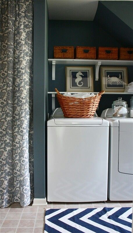 Good inspiration for hiding the water heater between the washer and dryer. Nice color's too.