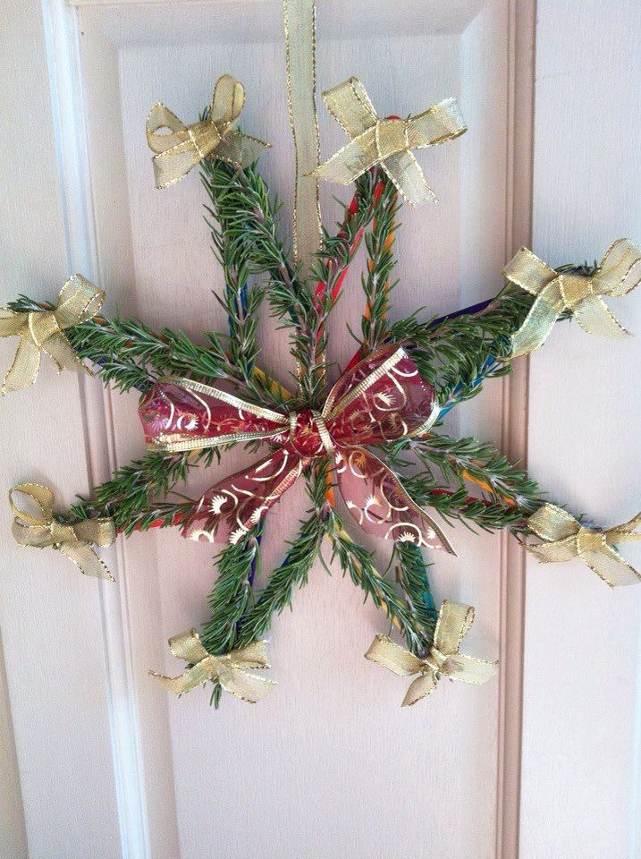 Christmas door decoration made from icy pole (lolly) sticks, hot glue and rosemary.