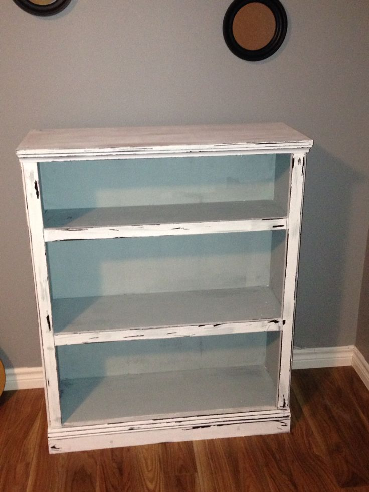 A bookcase I made into a distressed vintage look using Americana decor chalk paint in colors vintage and everlasting