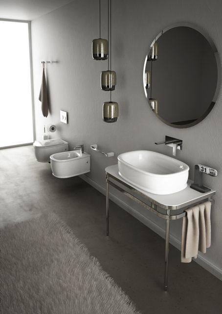 Azuley, design Meneghello Paolelli Associati. Collezione bagno di lavabi e sanitari.  Sanitari sospesi, lavabo consolle e specchio tondo / Wall hung sanitaries, washbasin consolle and round mirror. #bathroom #sanitaries #design #washbasin #lavabi #sanitari #bagno