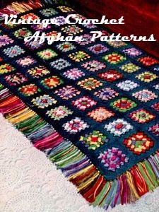 Gorgeous Fringe....I can't imagine how long this took to make this Granny Square Blanket #Crochet