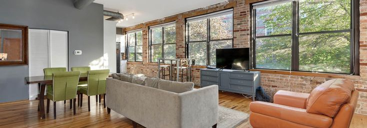 South-facing windows let in plenty of light in this 2-bedroom loft in Wicker Park, Chicago, IL #loft #wickerpark #brick #chicago #apartment