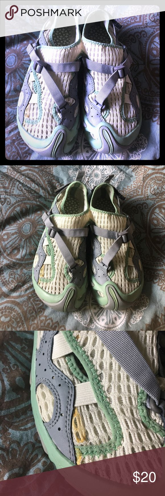 TEVA Water Shoes Green and white mesh water shoes by TEVA. Two adjustable straps for a perfect fit. Little discoloration on right shoe, looks like glue, as seen in picture. Otherwise, great condition, hardly worn. Teva Shoes Athletic Shoes