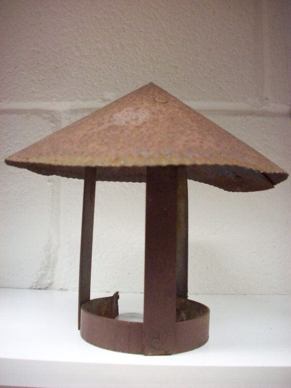 This metal chimney cap was salvaged from my 1953 ranch home roof. It topped an old clothes dryer vent.  I think it would make great garden/ yard art or would look cool in a display of industrial or rustic type items.  It measures 7 1/2 tall by 8 1/2 across.  It is intact but shows surface rust over the entire piece.  I can ship this post since it is not fragile, unless the buyer prefers insurance. Convo me before purchase to pick a shipping method.  THE FINE PRINT:  Shipping cost stated is…