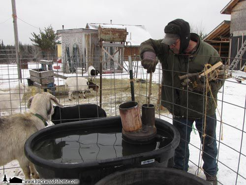 """Build a Wood-Fired Stock Tank Heater, by Jackie Clay-Atkinson. """"Could Will build a wood-fired stock tank heater for our homestead that would eliminate all that ice chopping?"""""""