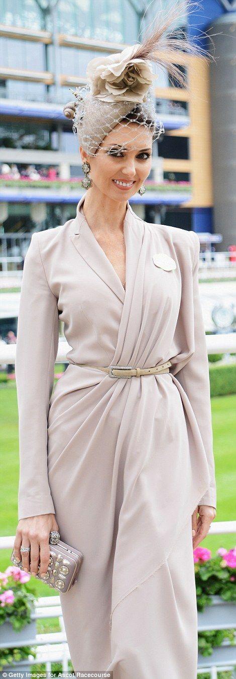 A racegoer was elegant in neutral shades...