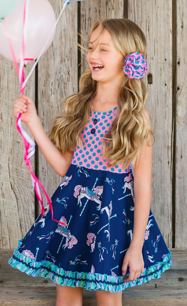 She's got a ticket to twirl in our new circle skirt dress with our fun carousel horse print!