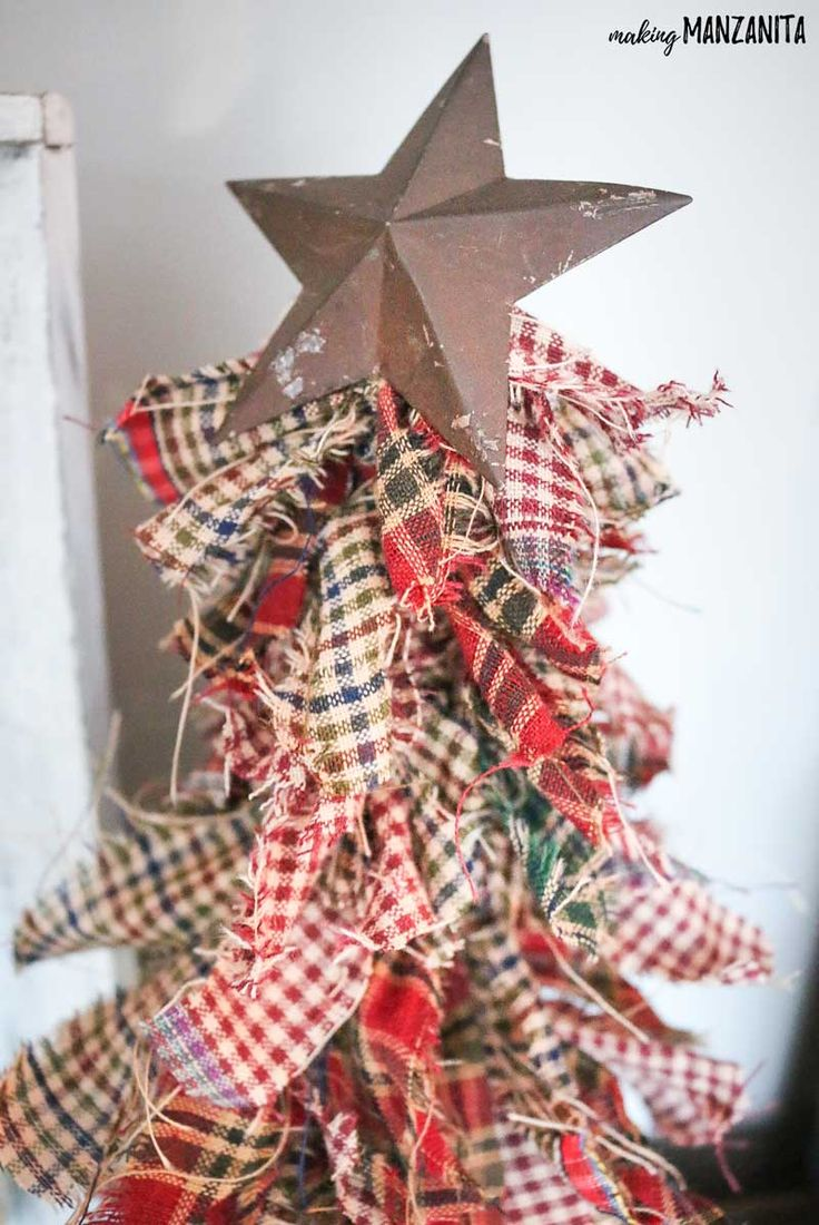 These easy-to-make primitive mini Christmas trees with homespun fabric are perfect rustic Christmas decorations for the mantel, shelf or tablescapes.