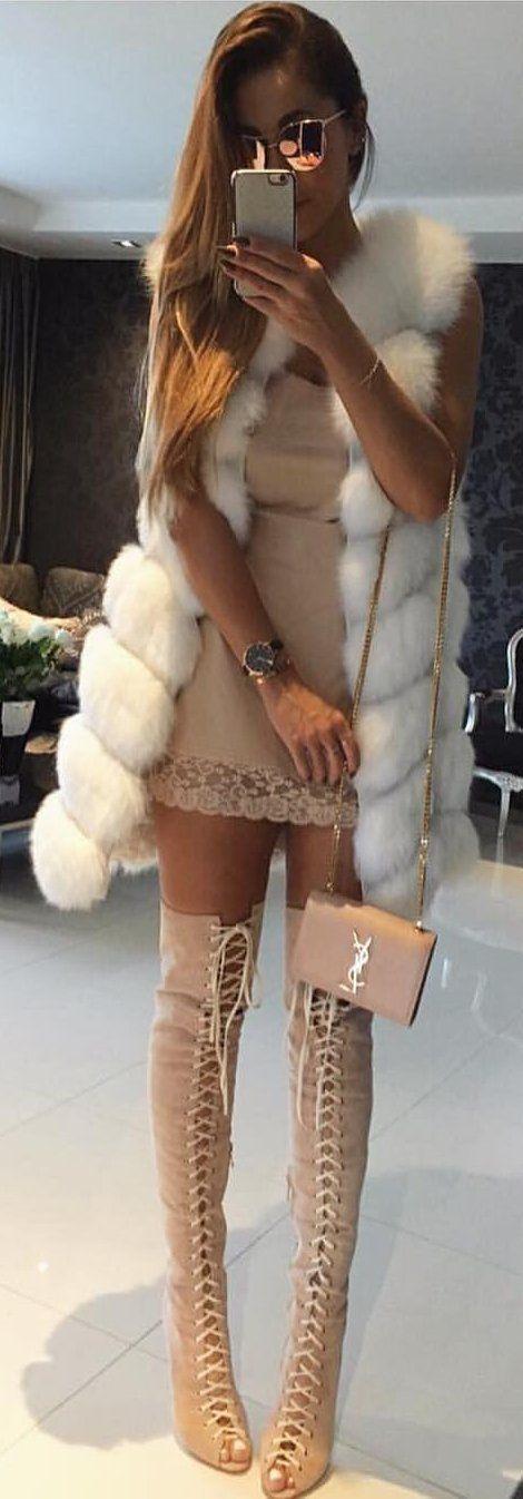 #winter #fashion /  White Faux Fur Vest / Tan Dress / Tan Laced Up OTK Boots