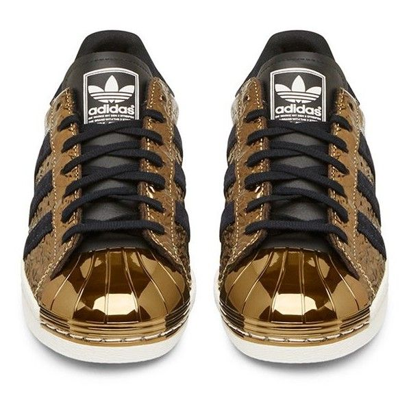 Adidas Originals Black and Gold Superstar Low Top Sneaker ($180) ❤ liked on Polyvore featuring shoes, sneakers, low top, adidas originals trainers, black and gold sneakers, adidas originals and low profile shoes