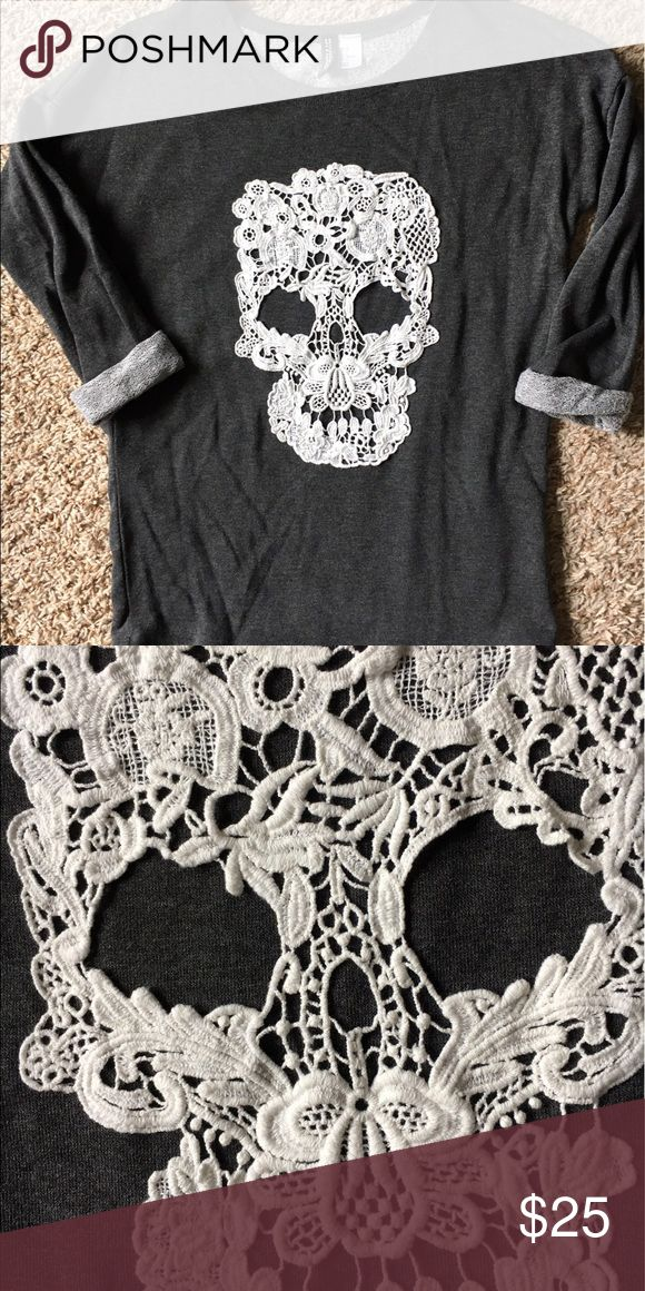 H&M Lace skull sweatshirt Divided by H&M lightweight 3/4 sleeve sweatshirt. Lace skull is awesome!! Super hard to find. EUC, it's like brand new😊 H&M Tops Sweatshirts & Hoodies