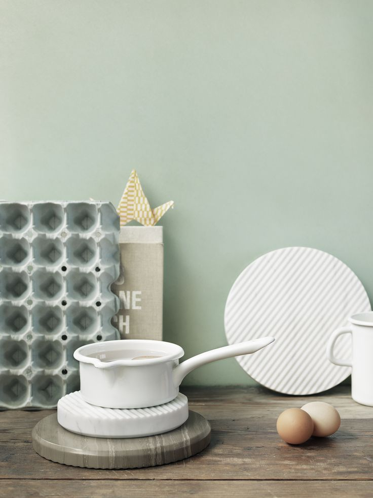 The decorative nature of the GROOVE trivets invite them to be displayed on the table even when not being used during serving. Cut from solid marble, the carefully carved grooves in the trivets allow air to flow under the trivet and the hot pan, preventing the trivets from getting too hot.  http://www.muuto.com/accessories/groove