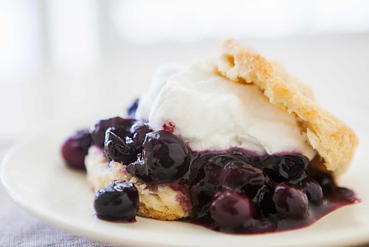 Blueberry Shortcake! With simmering blueberries, homemade biscuits, and whipped cream.