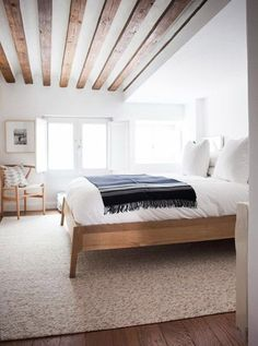 Minimalist bedroom with modern wood beam ceiling. home decor. interior decorating
