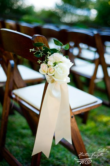 Great chair decor - I'd make the ribbon slightly smaller and add a bit more color to the flower selection. Would look great against white folding chairs if you do that.