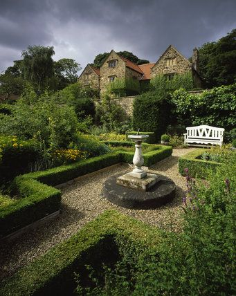 The lower garden at Washington Old Hall, Tyne and wear, England - Ancestral home of the family of George Washington, 1st President of the United States. Available for weddings and also home to the magnificent Topiary Gardens